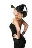 美丽的巫婆拿着一个帽子 免版税图库摄影