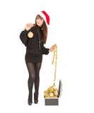 美丽的微笑的圣诞节圣诞老人妇女 免版税库存照片