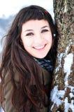 美丽的微笑的时间冬天妇女 免版税库存照片