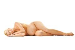美丽的怀孕的休眠的妇女 免版税库存照片