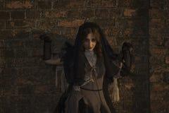 年轻美丽的恶魔般的女性 免版税库存照片