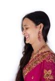 美丽的愉快的印第安桃红色莎丽服妇女 库存图片