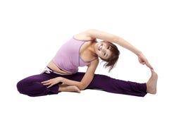 美丽的执行的女孩瑜伽年轻人 免版税库存照片