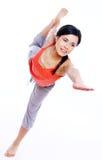 美丽的执行的执行女孩瑜伽年轻人 免版税库存图片