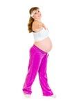美丽的执行的执行怀孕的微笑的妇女 库存图片