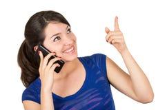 美丽的拉丁女孩谈话在她的细胞 库存照片