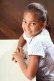 美丽的教室女小学生微笑年轻人 库存照片