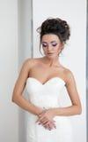年轻美丽的新娘画象在白色背景的 库存照片