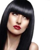 美丽的时尚妇女画象有长的头发的 免版税库存照片