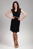 美丽的时装模特儿佩带的礼服 免版税库存照片