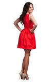美丽的时装模特儿佩带的礼服 免版税库存图片