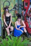 美丽的服装屏蔽二名妇女 免版税图库摄影