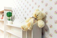 美丽的木碗柜在儿童居室 免版税库存照片