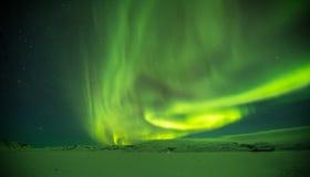 美丽的极光borealis在冰岛,在早冬天perio的射击 免版税库存照片