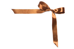 美丽的棕色丝带和弓,有益于设计。隔绝在白色背景 库存照片