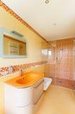 美丽的橙色卫生间 图库摄影