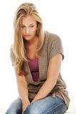 美丽的消沉妇女年轻人 免版税库存图片