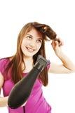 美丽的烘干机干毛发她的妇女年轻人 免版税图库摄影