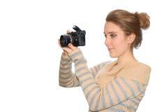 美丽的照相机女孩年轻人 免版税库存照片