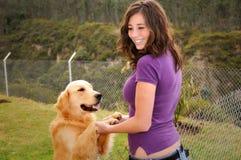 美丽的狗妇女 库存图片