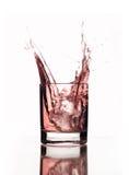 美丽的玻璃桃红色飞溅水 图库摄影