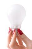 美丽的电灯泡现有量妇女 库存照片