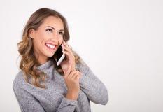 美丽的电话联系的妇女 免版税库存图片