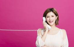 美丽的电话联系的妇女 库存图片