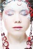 美丽的白肤金发的冬天雪女王/王后 免版税库存图片