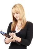 美丽的白肤金发的剪贴板藏品妇女 免版税库存照片
