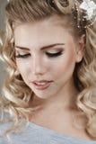 美丽的白肤金发的少妇 图库摄影