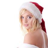 美丽的白肤金发的帽子圣诞老人妇女 库存图片