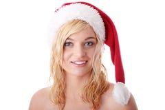 美丽的白肤金发的帽子圣诞老人妇女 库存照片