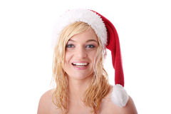 美丽的白肤金发的帽子圣诞老人妇女 免版税图库摄影