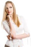 美丽的白肤金发的斟酌的妇女年轻人 库存照片