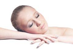 美丽的白肤金发的查出的休眠时间妇女年轻人 库存图片