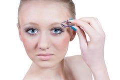 美丽的白肤金发的查出的构成妇女年轻人 库存图片