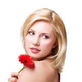 美丽的白肤金发的花妇女 免版税库存照片