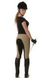 美丽的白肤金发的骑师妇女年轻人 免版税库存图片