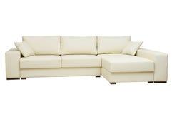 美丽的皮革在白色的沙发米黄颜色 库存照片