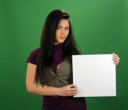美丽的看板卡女孩暂挂青少年的白色 免版税库存图片