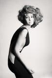 美丽的礼服典雅的夫人年轻人 免版税图库摄影