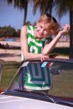美丽的礼服楼层女孩坐的夏天 免版税图库摄影