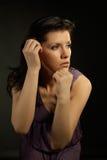 美丽的礼服淡紫色佩带的妇女 库存图片