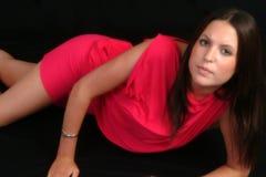 美丽的礼服红色佩带的妇女 库存图片
