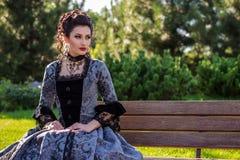 美丽的礼服葡萄酒妇女 图库摄影
