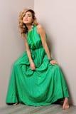 美丽的礼服长的妇女 免版税库存照片