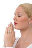 美丽的祈祷的妇女 库存照片