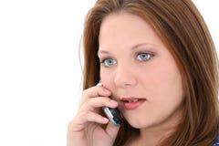 美丽的移动电话告诉的妇女年轻人 库存照片
