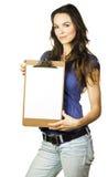 美丽的空白剪贴板女孩藏品纸张 免版税库存图片